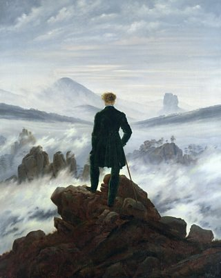 Oil painting of a figure seen from behind looking out over a foggy landscape through which the tops of mountains emerge