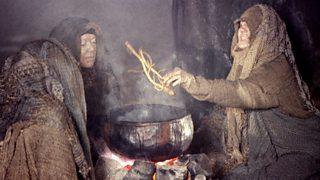 The three Witches, huddled around a cauldron