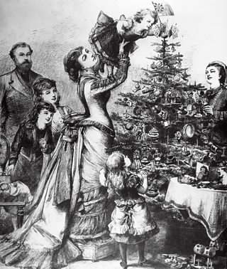 A Victorian family decorate a Christmas tree