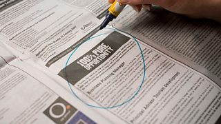 Job advertisement in a newspaper with a circle drawn around it.