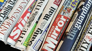 A selection of rolled up national newspapers