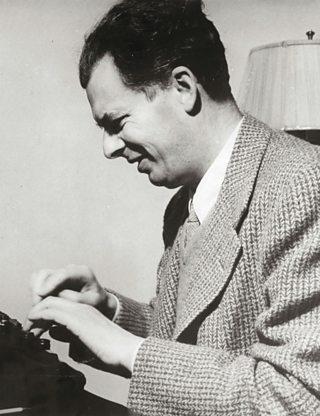 Aldous Huxley typing on a typewriter