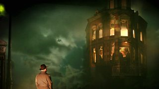 Picture from a stage production of An Inspector Calls with Inspector Goole standing outside the Birlings home in the fog.