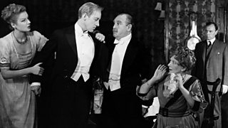 Photo from British premiere of An Inspector Calls.  Mr and Mrs Birling are shocked by Eric's confession.