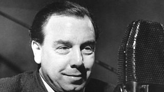 A black and white photo of J B Priestley recording for the BBC
