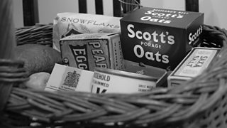A black and white photo of food rations in a basket