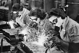 A photo of women welders making stirrup pump handles during World War Two.