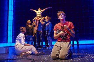 Photo from a stage production of Curious Incident of the Dog in the Night-Time with Christopher and the ensemble cast