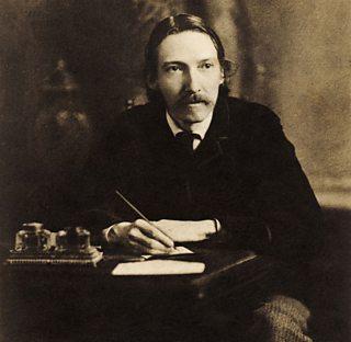 Robert Louis Stevenson, writing at his desk.