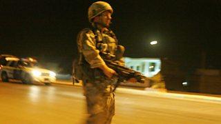 A British soldier on patrol in Iraq