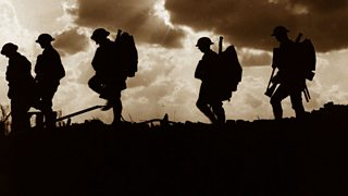 Five soldiers silhouetted against the sky at the Battle of Broodseinde during World War One.