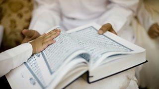A photo of children holding the Koran