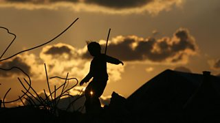 A silhouette of a girl running across the land