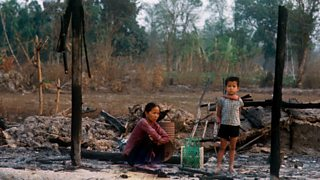 A Vietnamese woman and child among ruins