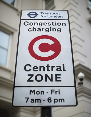 A sign advising the public of the congestion charge zone in London