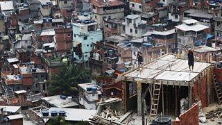 Building work goes on in Brazilian favelas.