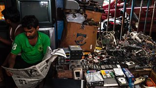 A photo showing how e-waste is sorted and sold on a street in Kolkata