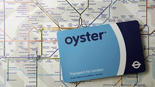 Oyster card with tube network map behind it