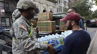 Hurricane Sandy aid workers unload supplies