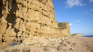 Sandstone cliffs and beach at West Bay, Bridport, Dorset, England
