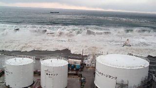 Rising sea water from the March 2011 tsunami breaching the sea defences by the Fukushima Daiichi nuclear power station on Japan's Pacific coast.