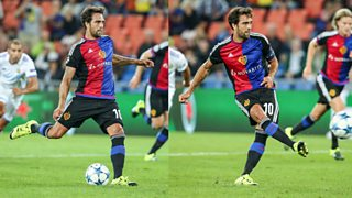 The preparation and contact phase in football as a footballer kicks a ball