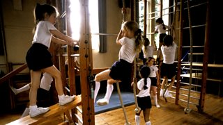 Girls and boys on school climbing apparatus