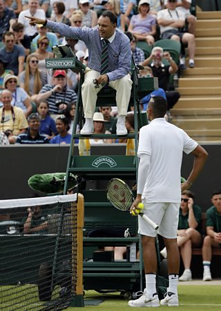 A tennis player argues with the chair umpire at Wimbledon