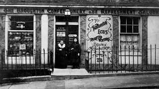 Italian shop owners standing outside their confectionery shop in Edinburgh in the 1920s
