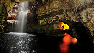 Underground waterfall in a cave