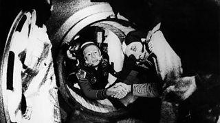 Image of American astronaut Thomas Stafford and Russian cosmonaut Aleksey Leonov shaking hands in space in 1975.