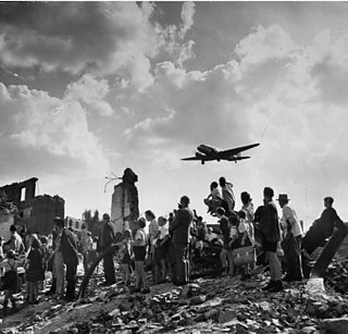 Photograph of cargo planes dropping relief supplies in the Berlin Airlift