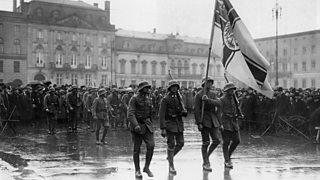 Photo showing Putschists marching with the Imperial War Flag at Pariser Platz Square.