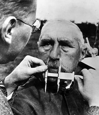 Image showing a man having his nose measured during Aryan race determination tests under Nazi Germany's Nuremberg Laws that was applied to determine whether a person was considered a 'Jew'.