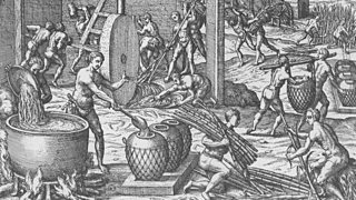 Illustration of sugar manufacturing and refining from De Bry's voyages in the 16th century.