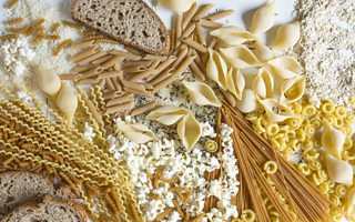 A selection of starchy foods, including pasta, rice and bread