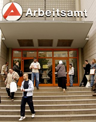 Job seekers enter and leave the Arbeitsamt or German Labour Office in the Wedding district of Berlin, Germany