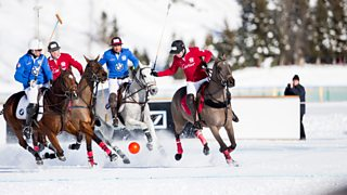 Members of the 'Cartier' team battle for the ball with team 'BMW' during the final of the Snow Polo World Cup