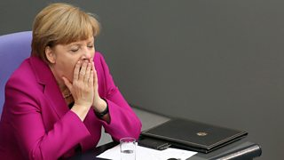 German Chancellor Angela Merkel yawns after giving a government declaration during a meeting of the Bundestag, the German federal parliament, on June 4, 2014 in Berlin, Germany.