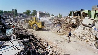 A team clearing rubble after an earthquake, Bhuj, India