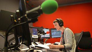 Radio news presenter in BBC Broadcasting House in London