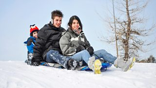 Three children playing and having fun outdoors during winter time