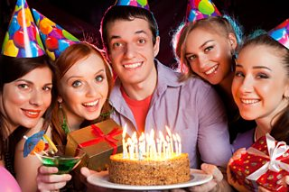 Cheerful birthday celebrations with a cake and candles