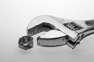 Studio photograph of a wrench and nut