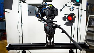A slider set up on top of a tripod.