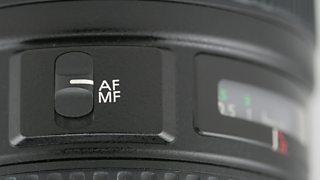 The autofocus switch on a DSLR lens