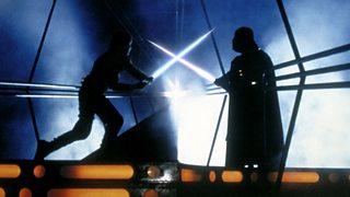 A lightsaber duel between Luke Skywalker and Darth Vader