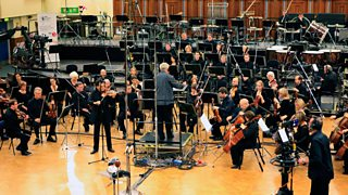 An orchestra recording a musical score