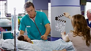 An actor from Casualty wearing a nurses uniform