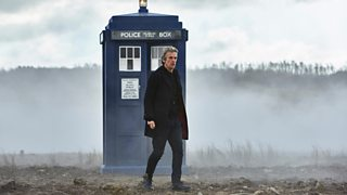 Peter Capaldi as Dortor Who with the TARDIS in the background